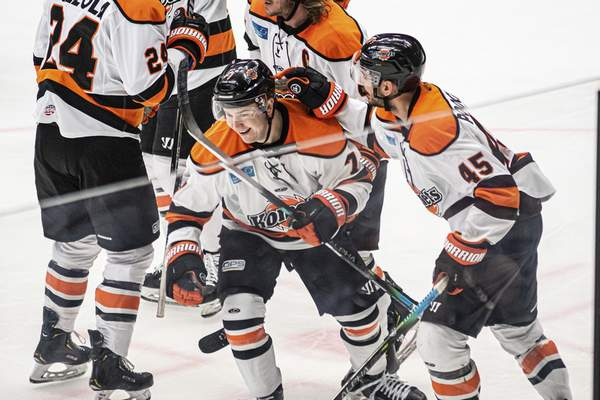 Zack Rawson | Special to The Journal Gazette Komets forward Brandon Hawkins, middle, celebrates with teammates, including Zach Pochiro, right, after scoring in the first period Wednesday at Wheeling, West Virginia.