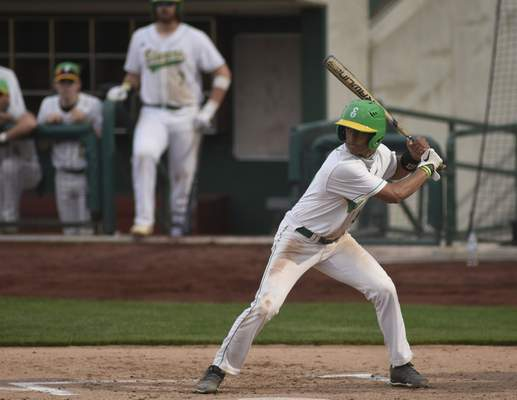 Mike Moore | The Journal Gazette Eastside outfielder Wade Miller at bat in the third inning against DeKalb at Parkview Field on Wednesday.