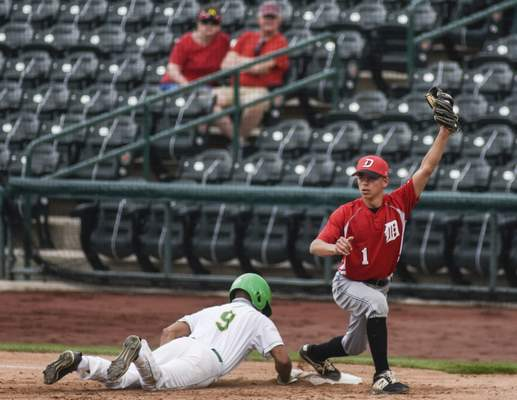 Mike Moore | The Journal Gazette Eastside outfielder Wade Miller slides into first base but is late to the bag as DeKalb first baseman Logan Greer catches the ball for the out in the third inning at Parkview Field on Wednesday.