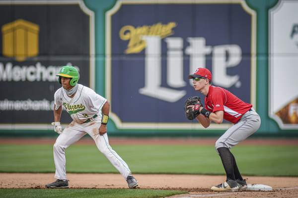 Mike Moore | The Journal Gazette Eastside outfielder Wade Miller, left leads off base as DeKalb first baseman Logan Stahly watches for the pitch in the first inning at Parkview Field on Wednesday.