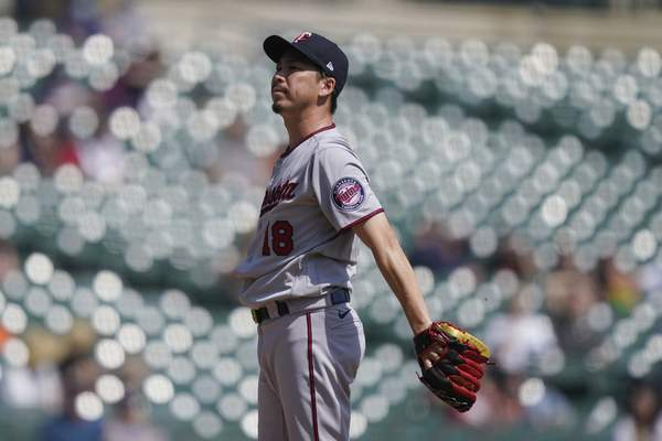 Minnesota Twins starting pitcher Kenta Maeda reacts after giving up a solo home run to Detroit Tigers' Wilson Ramos during the fifth inning of a baseball game, Wednesday, April 7, 2021, in Detroit. (AP Photo/Carlos Osorio)