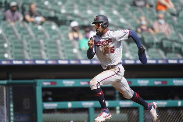 Minnesota Twins' Byron Buxton runs home to score on teammate Willians Astudillo's sacrifice fly to right during the fifth inning of a baseball game against the Detroit Tigers, Wednesday, April 7, 2021, in Detroit. (AP Photo/Carlos Osorio)
