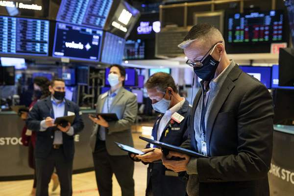 In this photo provided by the New York Stock Exchange, traders work on the floor Wednesday, April 7, 2021. (Colin Ziemer/New York Stock Exchange via AP)