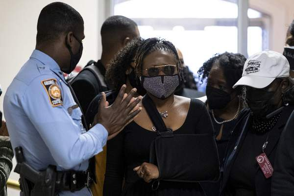 Georgia State Rep. Park Cannon, D-Atlanta, walks past a Georgia State Patrol officer as she returns to the State Capitol in Atlanta on Monday morning, March 29, 2021 after being arrested last week for knocking on the governor's office door as he signed voting legislation. (AP Photo/Ben Gray)