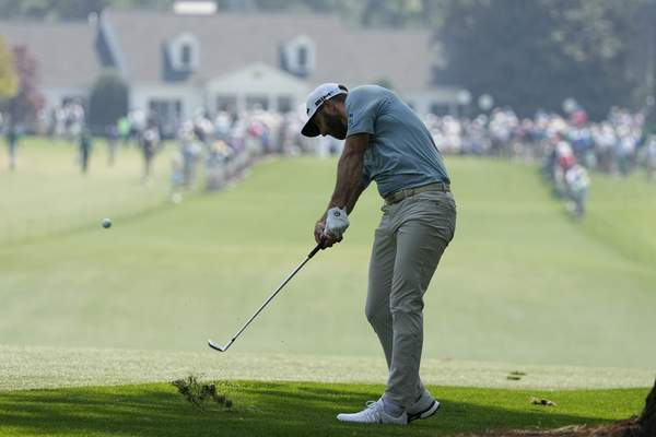 Associated Press Dustin Johnson hits on the first fairway during a practice round for the Masters on Wednesday in Augusta, Ga.