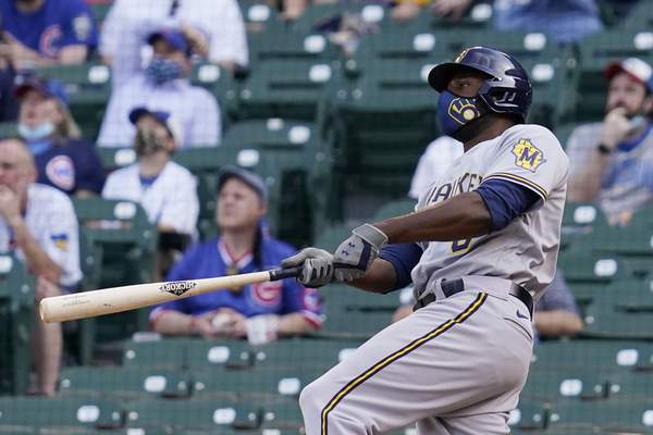 Associated Press Milwaukee's Lorenzo Cain watches after hitting a three-run home run  during the 10th inning Wednesday in Chicago.