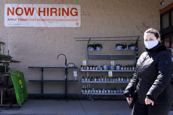A hiring sign is seen outside home improvement store in Mount Prospect, Ill., Friday, April 2, 2021. (AP Photo/Nam Y. Huh)
