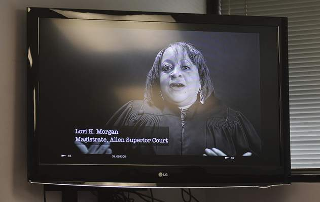 Katie Fyfe | The Journal Gazette One of a series of videos made by Blacklight Media to inform people about vaccinations is shown during Thursday's news conference.