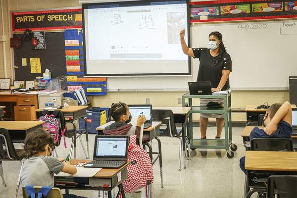 Mike Moore | The Journal Gazette  Holland Elementary School teacher Kapree Sisson is photographed in class in September. Fort Wayne Community Schools has experienced few cases of student-to-student COVID-19classroom spread.