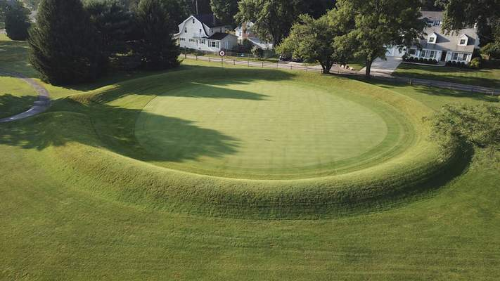 This photo made on July 30, 2019 shows a 155 ft. diameter circular enclosure around hole number 3 at Moundbuilders Country Club at the Octagon Earthworks in Newark, Ohio. (Doral Chenoweth III/The Columbus Dispatch via AP,)