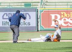 Michelle Davies | The Journal Gazette Wayne's LaDarius Griggs tags Northrop's Hunter McNeal at second in the third inning Tuesday at Parkview Field.
