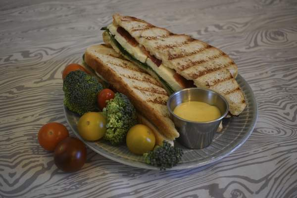 Photos by Corey McMaken | The Journal Gazette A Mozzarella and Bacon Sandwich with Spinach and Honey Mustard is a great mix of textures and flavors.
