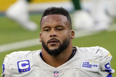 Aaroin Donald Assault Allegation Football FILE - Los Angeles Rams defensive end Aaron Donald (99) walks off the field after a loss to the New York Jets in an NFL football game in Inglewood, Calif., in this Sunday, Dec. 20, 2020, file photo. A lawyer and his 26-year-old client told Pittsburgh police Wednesday, April 14, 2021, that Los Angeles Rams defensive lineman Aaron Donald and others assaulted the man at a nightclub last weekend, causing multiple injuries. (AP Photo/Jae C. Hong, File) (Jae C. Hong STF)