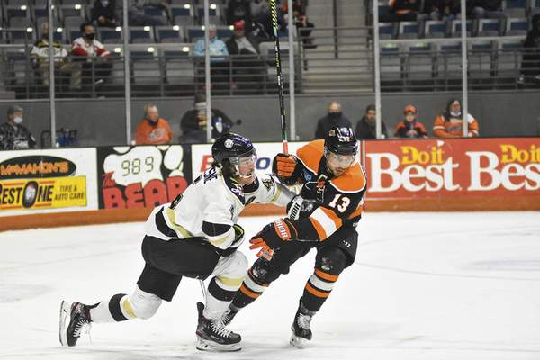 Katie Fyfe | The Journal Gazette  Wheeling Nailers defenseman Chad Duchesne and Komets forward Anthony Petruzzelli take off after colliding during the second period at Memorial Coliseum on April 3.