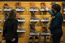 Retail Sales Associated Press  A salesperson helps a customer shopping for Bean Boots at the L.L. Bean flagship retail store in March in Freeport, Maine. (Robert F. BukatySTF)