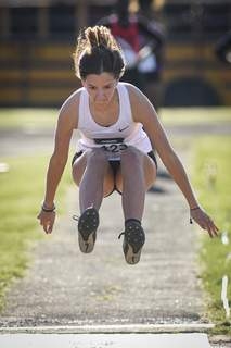 Mike Moore | The Journal Gazette Isabel Zuk competes in the long jump on Friday during the girls 1st Legend Relays at North Side High School.