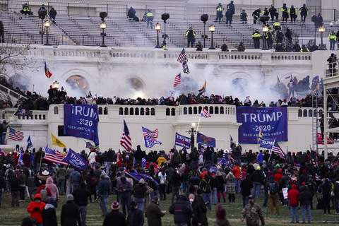 Capitol Breach Security FILE - In this Jan. 6. 2021, file photo, people storm the Capitol in Washington. A blistering internal report by the U.S. Capitol Police describes a multitude of missteps that left the force unprepared for the Jan. 6 insurrection â€
