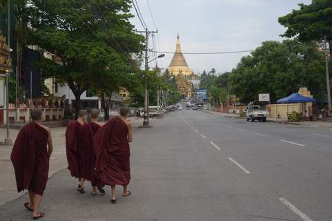 Myanmar Young Buddhist monks walk on a road leading to the Shwedagon Pagoda in Yangon, Myanmar Friday, April 16, 2021. Opponents of Myanmar's ruling junta went on the political offensive Friday, declaring they have formed an interim National Unity Government comprising elements of the ousted government of Aung San Suu Kyi as well as prominent members of major ethnic minority groups. (AP Photo) (STR)