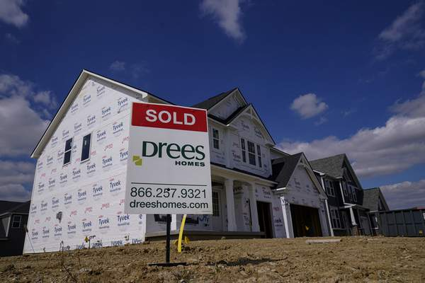 """Associated Press  A """"sold"""" sign sits on a lot as new-home construction continues in Westfield, Ind, in this September 2020 photo."""