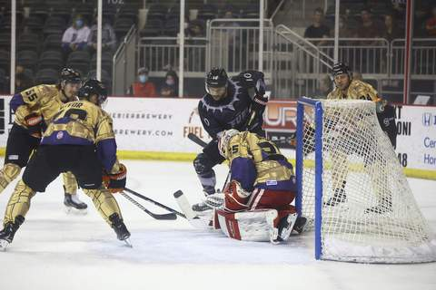 Whiteshark Photography  Komets goaltender Robbi Beydoun, making his professional debut, stops a shot from the Indy Fuel's Colton Heffley, top middle, on Saturday night in Indianapolis. (WHITESHARK PHOTOGRAPHY)