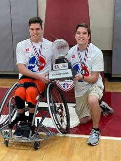 Courtesy Brothers AJ and Isaac Hummer of Waterloo pose with the trophy after helping Texas-Arlington win the National Wheelchair Basketball Association title in Tuscaloosa, Ala.