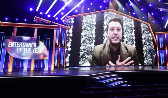 2021 Academy of Country Music Awards Luke Bryan appears on screen accepting the award for entertainer of the year at the 56th annual Academy of Country Music Awards on Sunday, April 18, 2021, at the Grand Ole Opry in Nashville, Tenn. (AP Photo/Mark Humphrey) (Mark Humphrey STF)