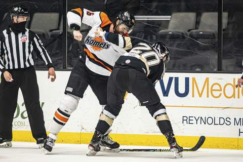 Zack Rawson | Special to The Journal Gazette  Komets forward Justin Vaive, left, fights the Wheeling Nailers' Kyle Marino on Sunday in Wheeling, West Virginia.
