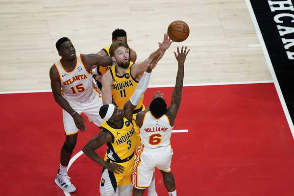 Indiana Pacers forward Domantas Sabonis (11) goes for the rebound against Atlanta Hawks guard Lou Williams (6) during the second half of an NBA basketball game on Sunday, April 18, 2021, in Atlanta. (AP Photo/Brynn Anderson)