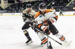Zack Rawson | Special to The Journal Gazette Komets defenseman Marcus McIvor chases the puck in the corner as he's followed by Wheeling's Austin Fyten on Sunday.