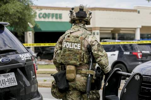 APTOPIX Austin Fatal Shooting Austin police, SWAT and medical personnel respond to an active shooter situation located Great Hills Trail in Northwest Austin, Texas, on Sunday, April 18, 2021. (Bront Wittpenn/Austin American-Statesman via AP) (Brontë Wittpenn MBR)