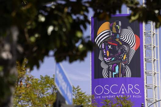93rd Academy Awards A sign advertising this year's Oscars ceremony is pictured near the Dolby Theatre, Thursday, April 15, 2021, in Los Angeles. The Dolby Theatre is one of the locations being used for the 93rd Academy Awards on Sunday, April 25. (AP Photo/Chris Pizzello) (Chris Pizzello STF)