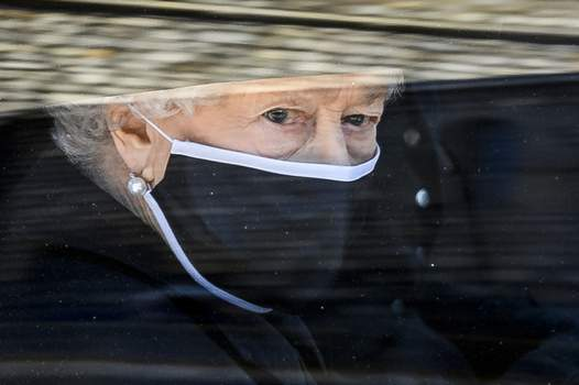 Britain The Queen FILE - In this Saturday April 17, 2021 file photo, Britain's Queen Elizabeth II follows the coffin in a car as it makes it's way past the Round Tower during the funeral of Britain's Prince Philip inside Windsor Castle in Windsor, England. (Leon Neal/Pool via AP, file) (Leon Neal POOL)