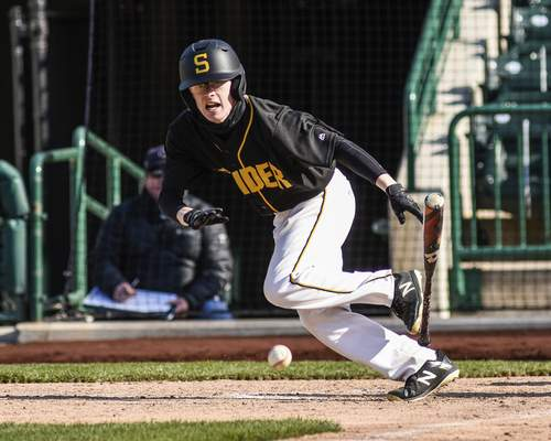 Mike Moore | The Journal Gazette Snider outfielder Blake Vervynckt bunts in the fourth inning against Norwell at Parkview Field on Thursday.