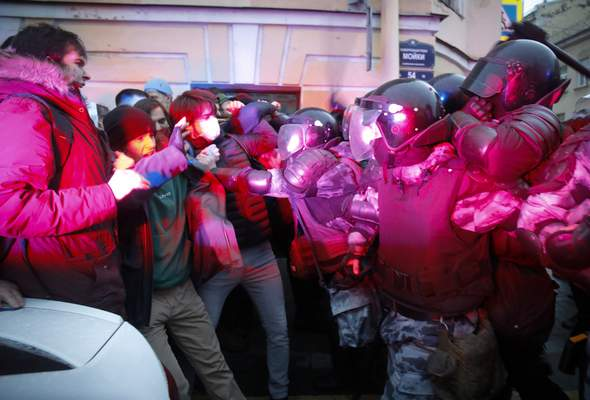 People clash with police during a protest in support of jailed opposition leader Alexei Navalny in St. Petersburg, Russia, Wednesday, April 21, 2021. (AP Photo/Dmitri Lovetsky)