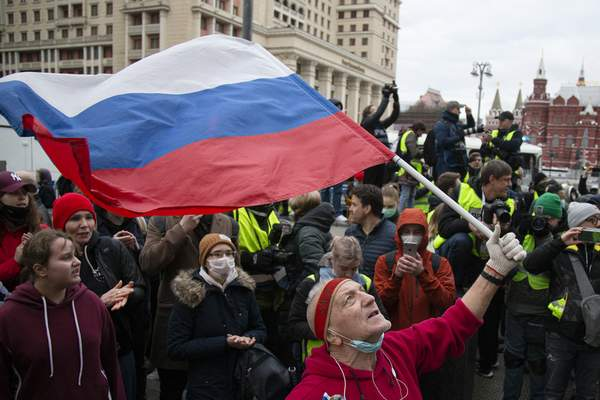 A supporter waves the Russian national flag and shouts slogans during the opposition rally in support of jailed opposition leader Alexei Navalny in the center of Moscow near Red Square, Russia, Wednesday, April 21, 2021. (AP Photo/Alexander Zemlianichenko)