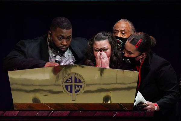 Katie and Aubrey Wright, parents of Daunte Wright, cry as the speak during funeral services of Daunte Wright at Shiloh Temple International Ministries in Minneapolis, Thursday, April 22, 2021. (AP Photo/Julio Cortez, Pool)