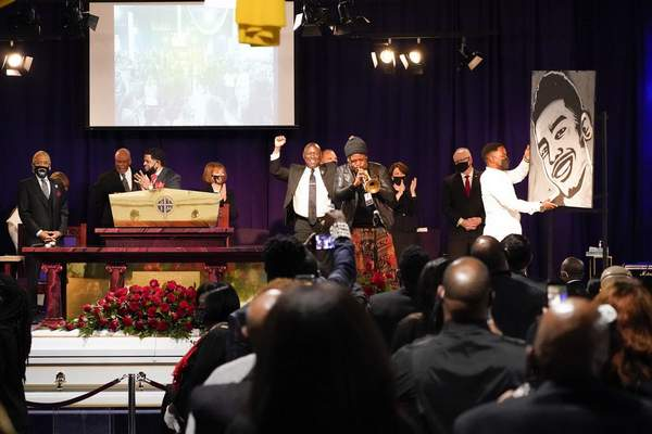 A musical and visual tribute are presented during funeral services for Daunte Wright at Shiloh Temple International Ministries in Minneapolis, Thursday, April 22, 2021. (AP Photo/Julio Cortez, Pool)