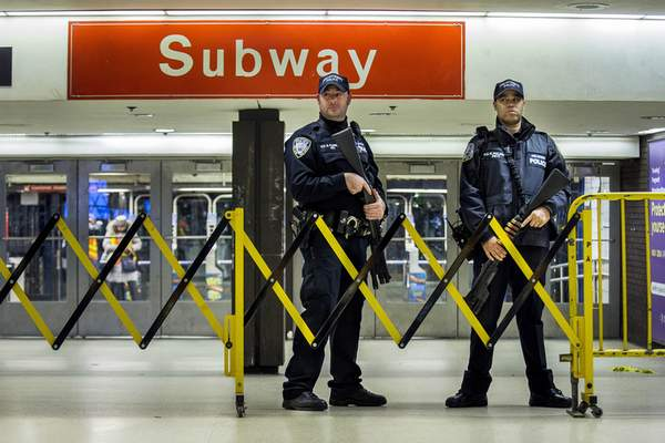 FILE - In this Dec. 11, 2017 file photo, police stand guard inside the Port Authority Bus Terminal following an explosion near Times Square, in New York. (AP Photo/Andres Kudacki, File)