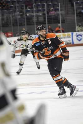 Mike Moore | The Journal Gazette Komets forward Shawn Szydlowski watches for the puck in the first period against Wheeling at Memorial Coliseum on Friday.