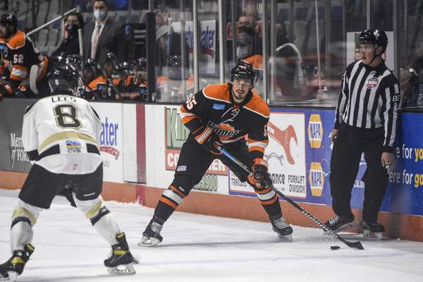 Mike Moore | The Journal Gazette Komets forward Jackson Leef eyes the net in the first period against Wheeling at Memorial Coliseum on Friday.