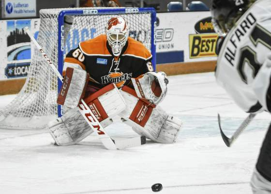 Mike Moore | The Journal Gazette Komets goalie Robbie Beydoun defends the net in the first period against Wheeling at Memorial Coliseum on Friday.