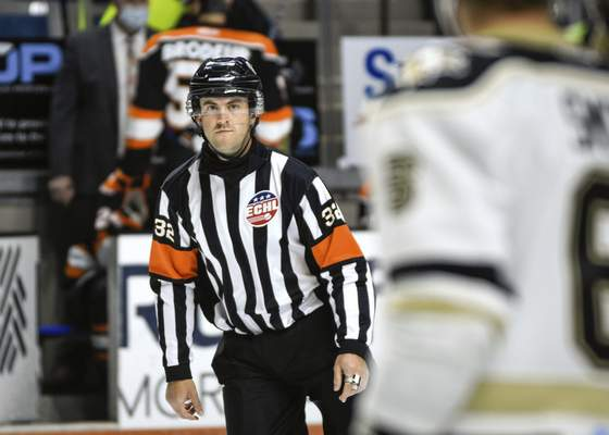 Mike Moore | The Journal Gazette Referee Mike Lekun officiating Friday nights game against the Komets and the Nailers at Memorial Coliseum.