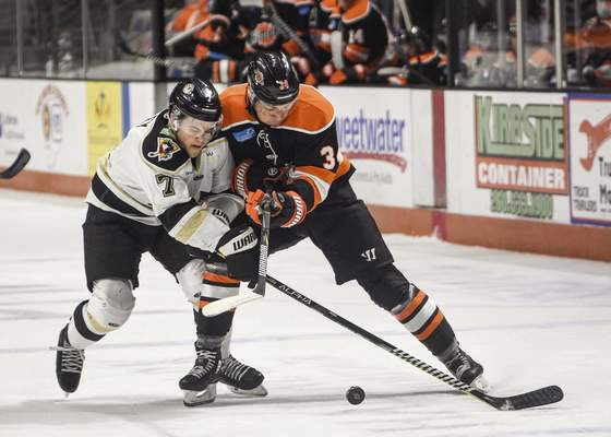 Mike Moore | The Journal Gazette Nailers defenseman Matt Foley, left and Komets forward Stephen Harper collide while chasing down the puck in the first period at Memorial Coliseum on Friday.