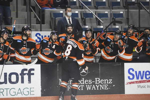 Katie Fyfe | The Journal Gazette Komets  defenseman Blake Siebenaler is congratulated by teammates following his second-period goal Saturday night against the Wheeling Nailers at Memorial Coliseum.