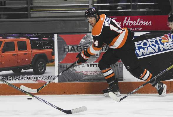 Katie Fyfe | The Journal Gazette  Komets forward Anthony Nellis carries the puck during the second period against the Wheeling Nailers at Memorial Coliseum on Saturday.