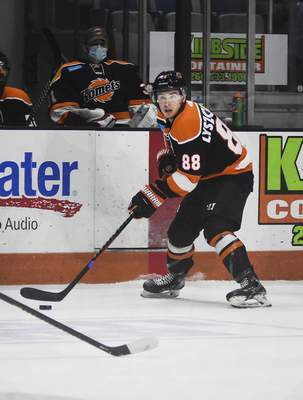 Katie Fyfe | The Journal Gazette  Komets forward Alan Lyszczarczyk looks to pass during the second period against the Wheeling Nailers at Memorial Coliseum on Saturday.