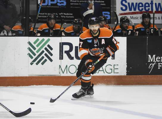 Katie Fyfe | The Journal Gazette  Komets forward Shawn Szydlowski looks to pass during the second period against the Wheeling Nailers at Memorial Coliseum on Saturday.