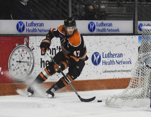Katie Fyfe | The Journal Gazette  Komets forward A.J. Jenks brings the puck around the net during the second period against the Wheeling Nailers at Memorial Coliseum on Saturday.
