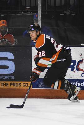 Katie Fyfe | The Journal Gazette  Komets defenseman Matt Murphy controls the puck during the second period against the Wheeling Nailers at Memorial Coliseum on Saturday.