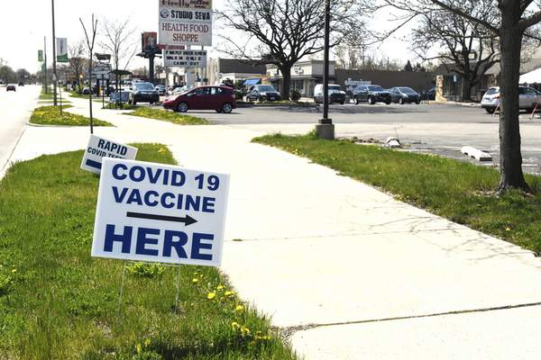 Michelle Davies | The Journal Gazette A sign indicates that COVID-19 vaccines are available at Three Rivers Pharmacy on North Anthony Boulevard.